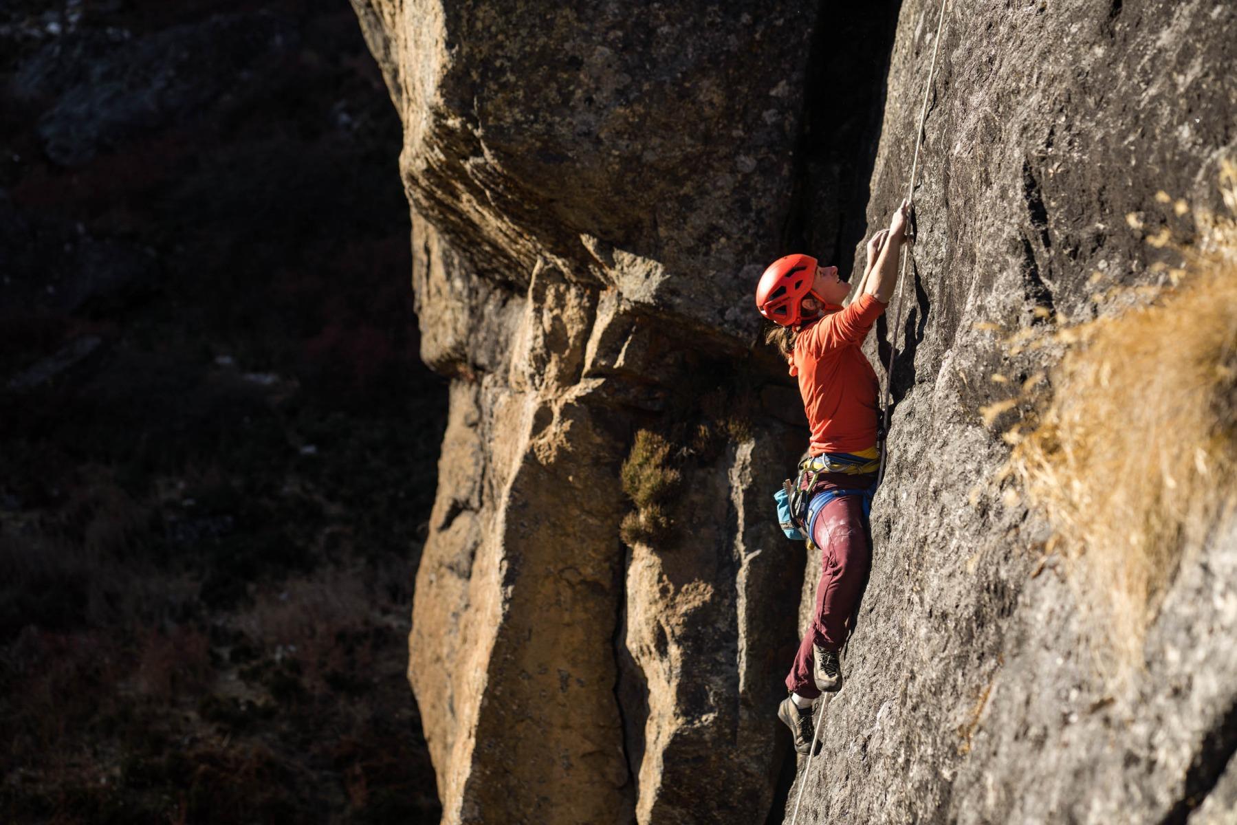 Side shot of Josie climbing.